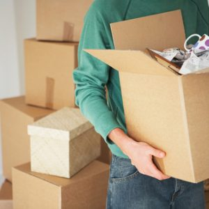 Man holding boxes whilst moving house