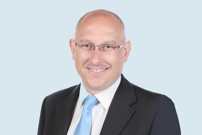 Tim Woolford Principal