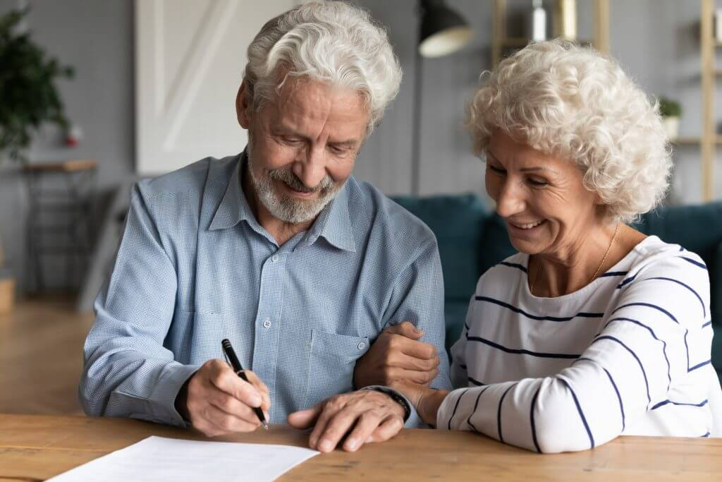 Two older people working with a Solicitor for the Elderly (SFE) accredited lawyer